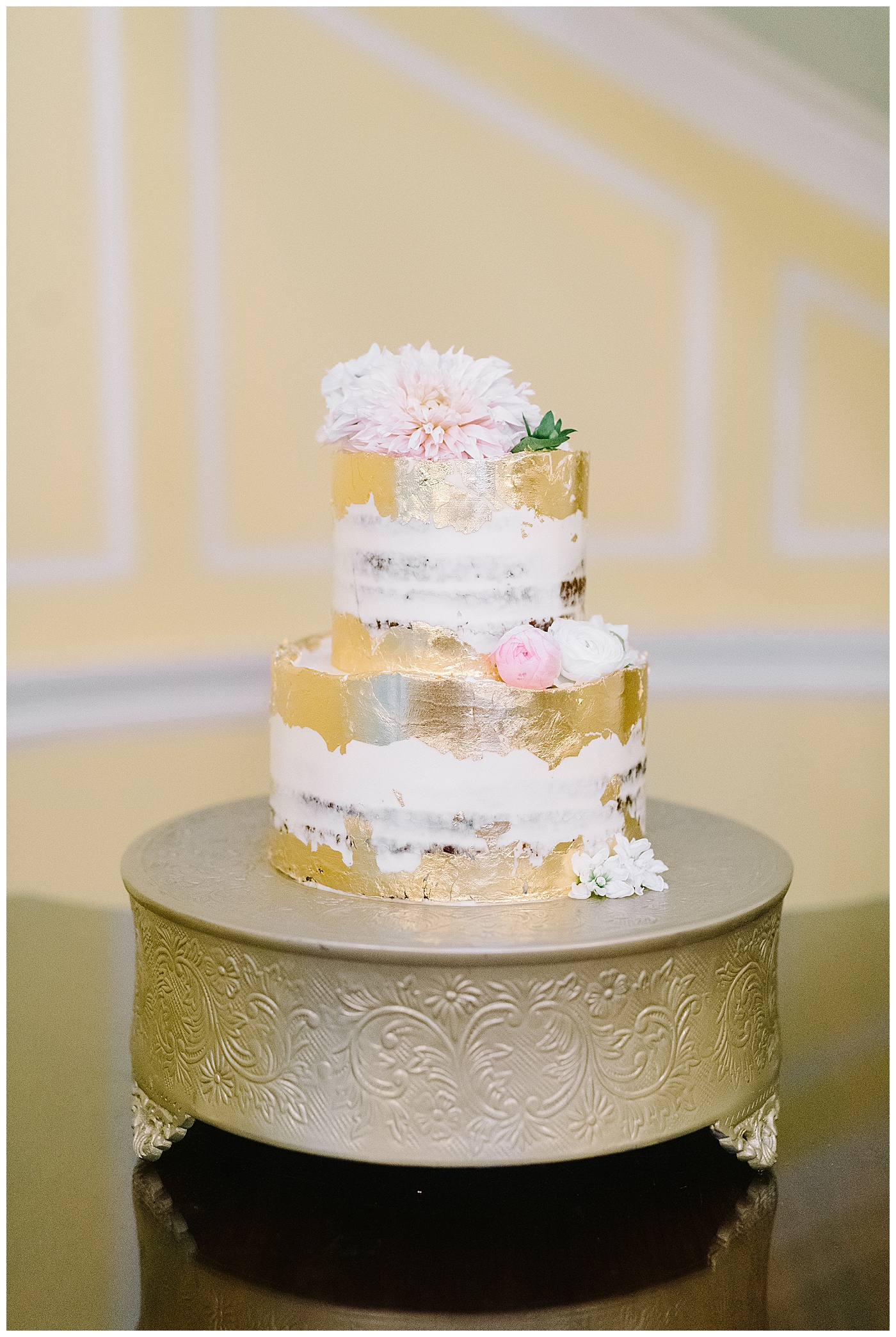 gold, white, and pink wedding cake