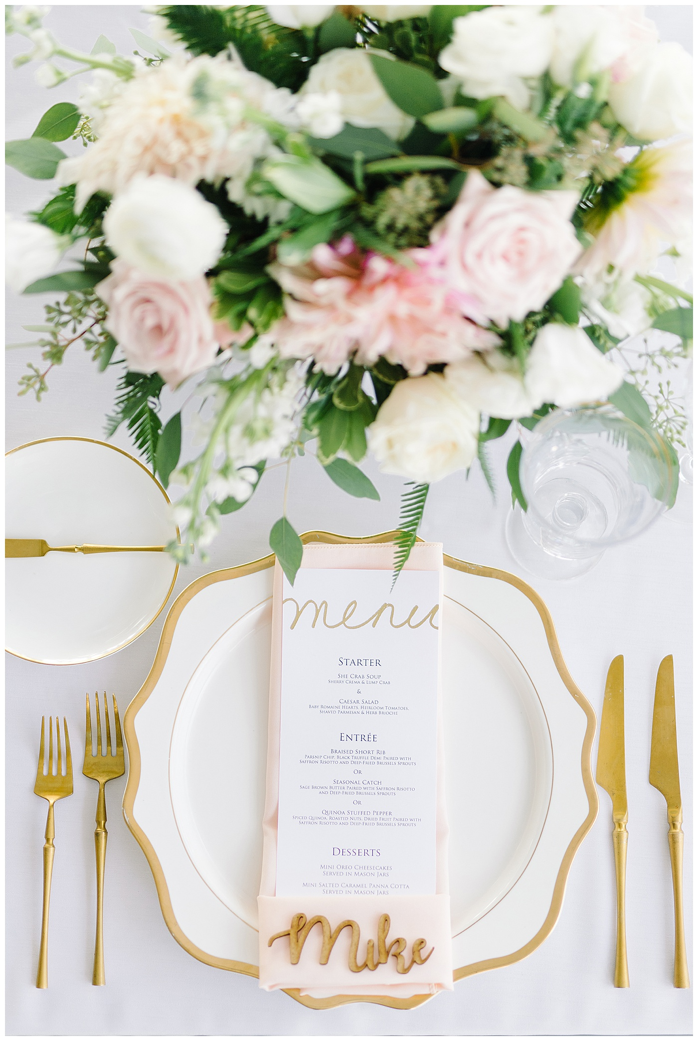 pink, white, and gold wedding reception place setting