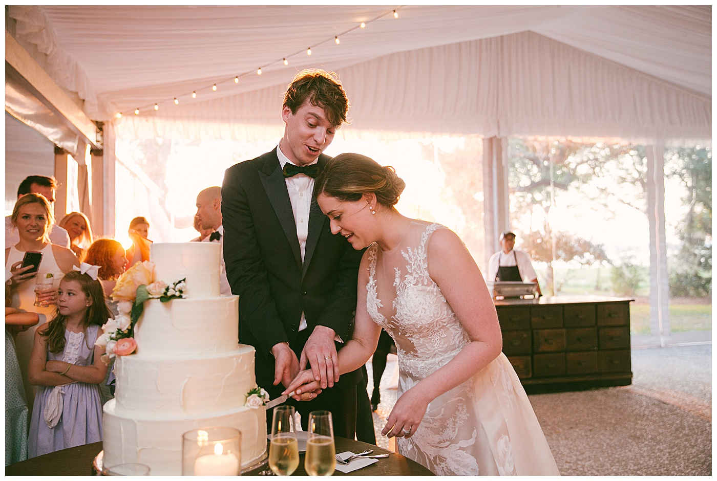 newlyweds cutting their wedding cake during reception
