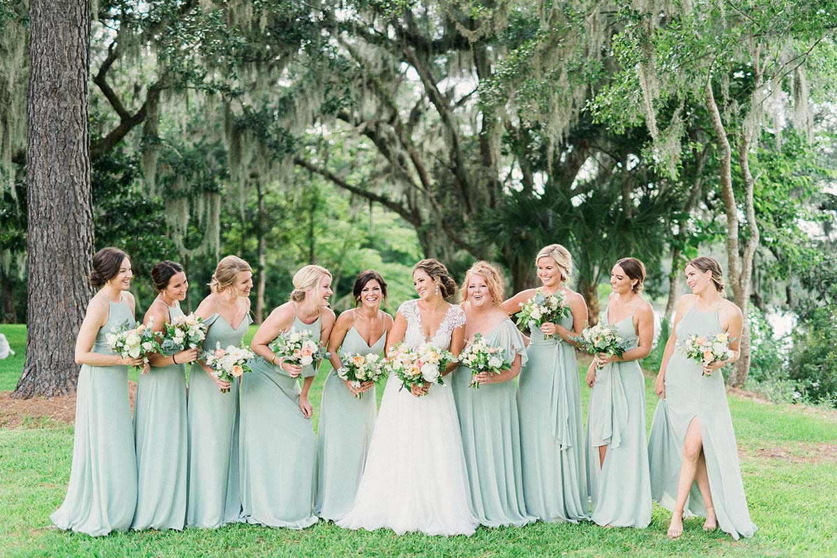 bridesmaids in light green gowns with bride