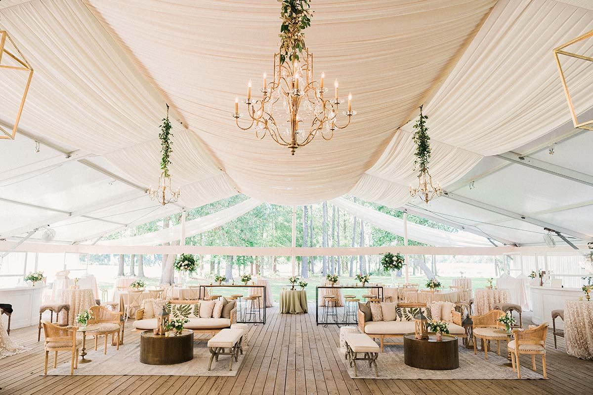 reception tent in neutral texture and greenery at Runnymede Plantation